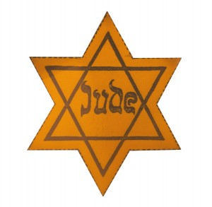 A yellow star, like those worn by Jewish people during WWII in Germany and wider Europe, to make them easily identifiable
