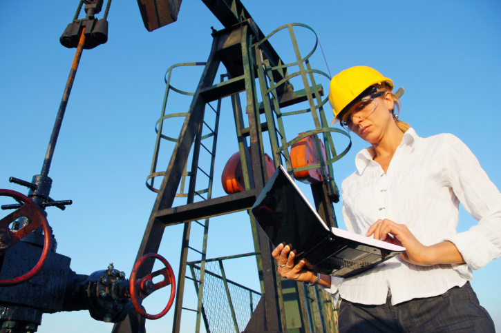 Businesswoman with a notebook in an oilfield. Engineer