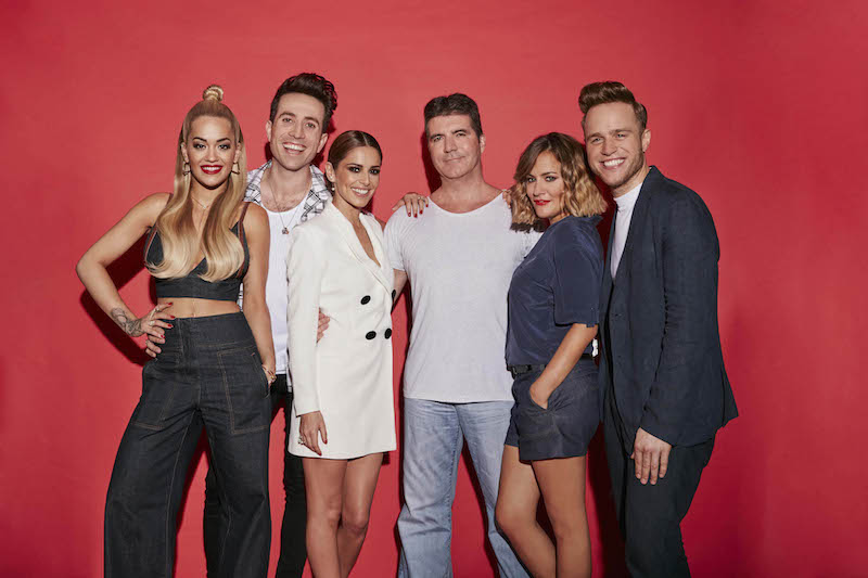 The X Factor is a Thames/Syco production for ITV. X FACTOR - Series 12 Expect The Unexpected… The X Factor returns to ITV Pictured: Rita Ora, Nick Grimshaw, Cheryl Fernandez-Versini, Simon Cowell, Caroline Flack and Olly Murs. Television's biggest search for a music star is back as The X Factor returns to ITV, with a new stellar judging panel and a dynamic new presenting duo. The brand new super six sees Simon Cowell, Cheryl Fernandez-Versini, Nick Grimshaw and Rita Ora take their places at the judges' desk, while presenters Olly Murs and Caroline Flack will be guiding the search to find a potential pop star with an amazing voice and that extra special something. This photograph is (C) Thames / Syco Entertainment and can only be reproduced for editorial purposes directly in connection with the programme or event mentioned above, or ITV plc. Once made available by ITV plc Picture Desk, this photograph can be reproduced once only up until the transmission [TX] date and no reproduction fee will be charged. Any subsequent usage may incur a fee. This photograph must not be manipulated [excluding basic cropping] in a manner which alters the visual appearance of the person photographed deemed detrimental or inappropriate by ITV plc Picture Desk. This photograph must not be syndicated to any other company, publication or website, or permanently archived, without the express written permission of ITV Plc Picture Desk. Full Terms and conditions are available on the website www.itvpictures.com For further information please contact: shane.chapman@itv.com / 0207 157 3043